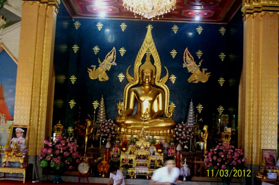 golden statue of Lord Buddha at thai monastery